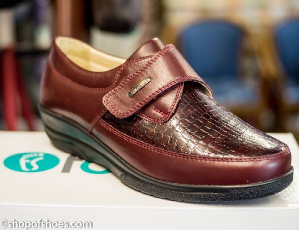 An extra soft and extra wide velcro deep wine leather shoe